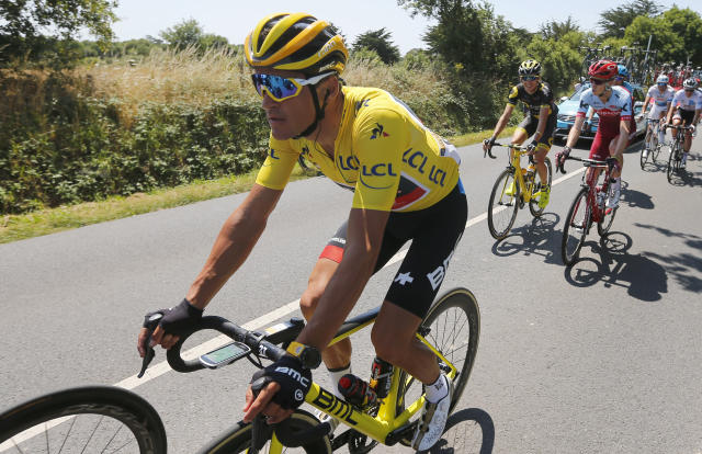Belgium's Greg van Avermaet, wearing the overall leader's yellow jersey rides in the pack during the fourth stage of the Tour de France cycling race over 195 kilometers (121 miles) with start in La Baule and finish in Sarzeau, France, Tuesday, July 10, 2018. (AP Photo/Peter Dejong)