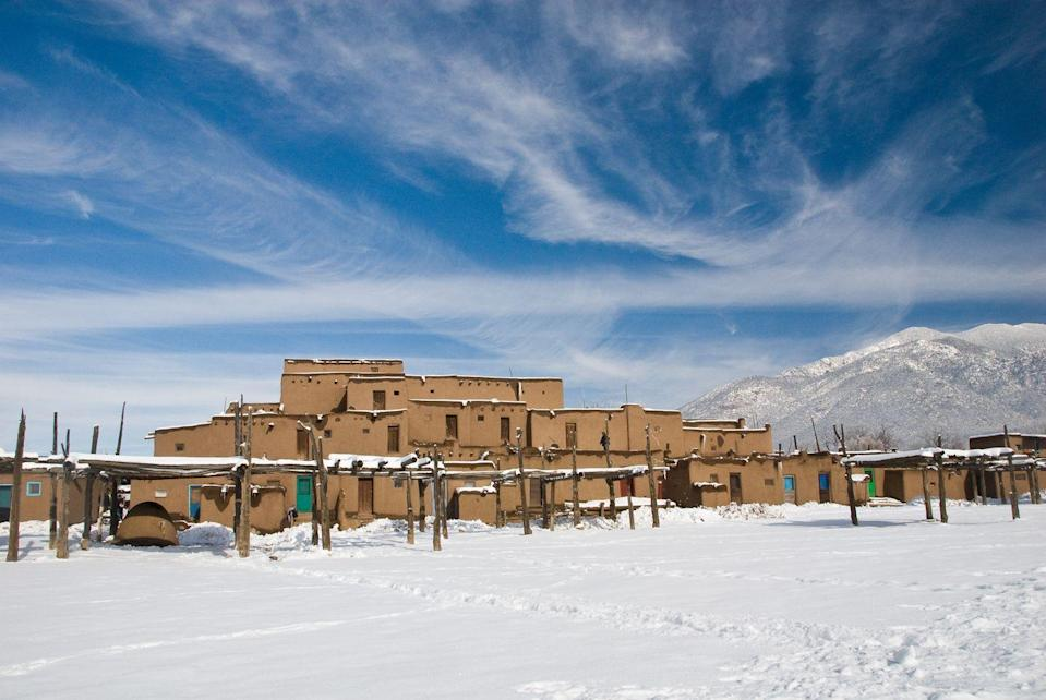 """<p>New Mexico is known for its stunning desert landscapes, but North of Santa Fe you can explore Taos, NM, a ski resort town with cute lodges, pretty vacation rentals and more. Nearby you can visit Taos Pueblo, a living Native American community that's also a National Historic Landmark and a <a href=""""https://whc.unesco.org/en/list/492/"""" rel=""""nofollow noopener"""" target=""""_blank"""" data-ylk=""""slk:UNESCO World Heritage Site"""" class=""""link rapid-noclick-resp"""">UNESCO World Heritage Site</a>.</p>"""