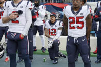 FILE - In this Dec. 15, 2019, file photo, Houston Texans wide receiver Kenny Stills (12) kneels during the national anthem before an NFL football game between the Texans and the Tennessee Titans in Nashville, Tenn. NFL players who want to kneel during the national anthem to protest police brutality and racism have far more support than Colin Kaepernick did four years ago. (AP Photo/Mark Zaleski, File)