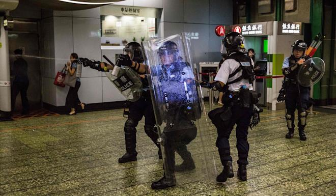 Police use pepper spray during clashes with protesters outside Kwai Chung Police Station. Photo: AP