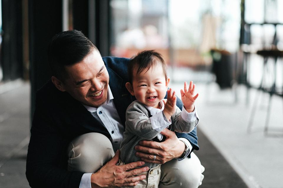 There was a professional photographer on hand to capture precious moments, such as Lachy with dad Ian. Source: Supplied/JackieLam