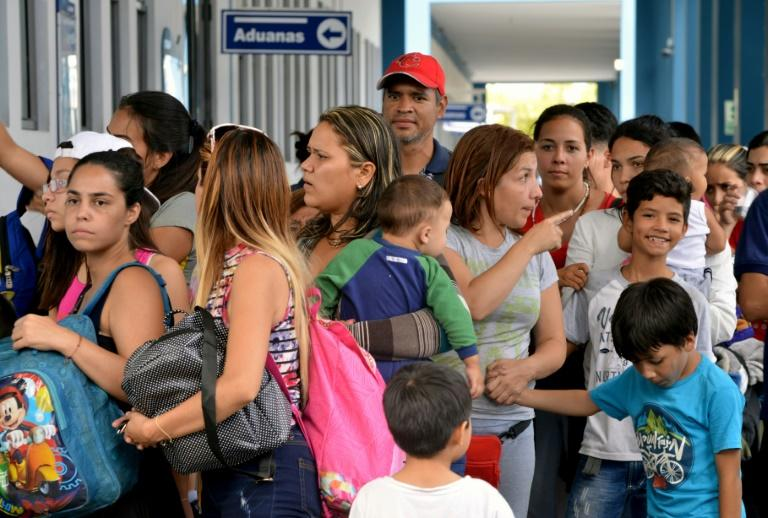 Many queueing at the border in Peru left Venezuela on foot weeks ago