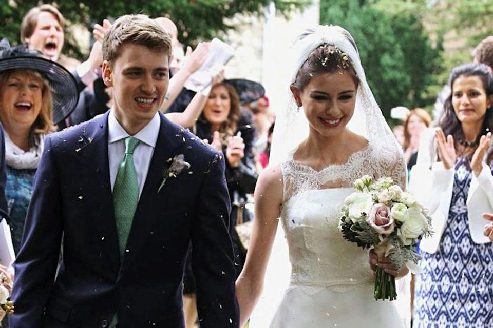 Here comes the bride: Euan Blair and Suzanne Ashman leaving the church