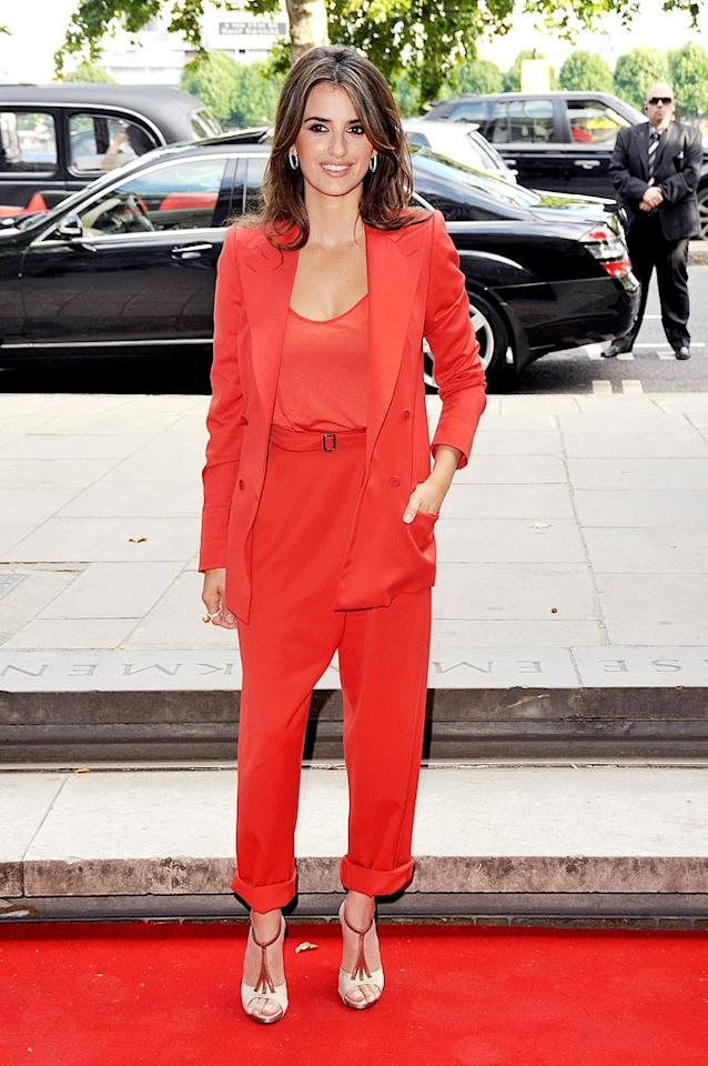 "Penelope Cruz is a gorgeous 35-year-old. Why then would she wear a tomato-red pantsuit fit for a woman twice her age? Jon Furniss/<a href=""http://www.wireimage.com"" target=""new"">WireImage.com</a> - July 30, 2009"