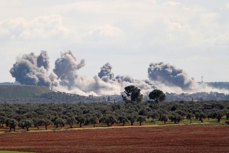 Smoke billowed over the village of Qaminas, southeast of Idlib, following reported Russian air strikes (AFP Photo/Ibrahim YASOUF)