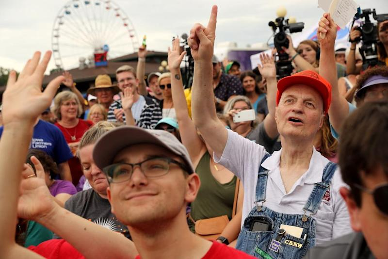 Audience members raise their hands to question Democratic presidential candidate Tom Steyer as he speaks at the Des Moines Register Political Soapbox at the Iowa State Fair in Des Moines, Iowa.