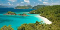 """<p>One of the U.S. Virgin Islands, along with St. Thomas and St. Croix, St. John steals the limelight from its siblings with its natural beauty - the majority of the island is a national park. There are scenic hiking trails on forested hills and beaches like Trunk Bay, one of the Caribbean's <a rel=""""nofollow noopener"""" href=""""https://www.bestproducts.com/lifestyle/g2209/best-beaches-for-vacations/"""" target=""""_blank"""" data-ylk=""""slk:prettiest strands"""" class=""""link rapid-noclick-resp"""">prettiest strands</a>. The only town, Cruz Bay, has a handful of laid-back restaurants like <a rel=""""nofollow noopener"""" href=""""https://www.tripadvisor.com/Restaurant_Review-g147410-d7911319-Reviews-The_Longboard_Coastal_Cantina-Cruz_Bay_St_John_U_S_Virgin_Islands.html"""" target=""""_blank"""" data-ylk=""""slk:The Longboard Coastal Cantina"""" class=""""link rapid-noclick-resp"""">The Longboard Coastal Cantina</a>. </p>"""