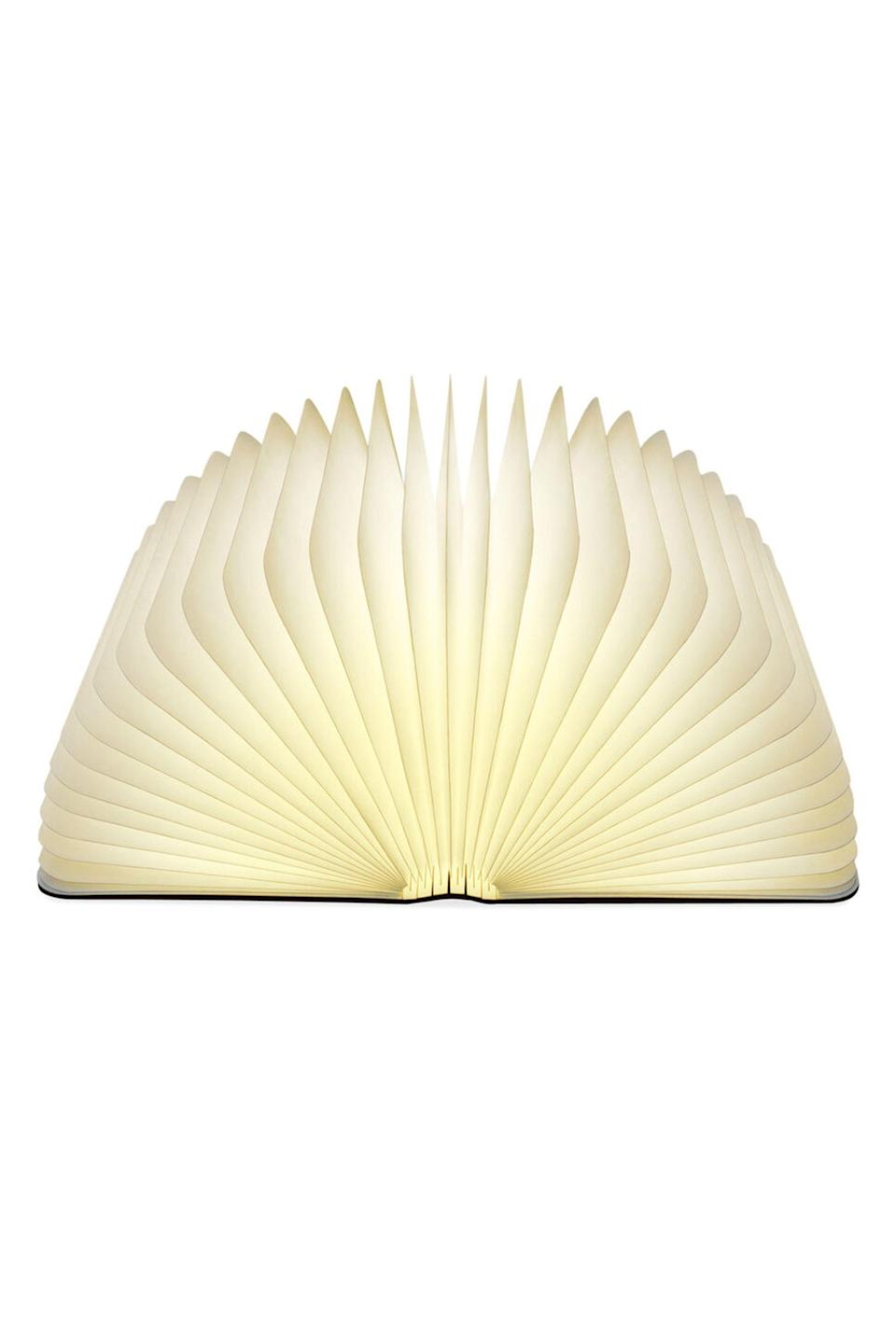 """<p>moma.org</p><p><strong>$200.00</strong></p><p><a href=""""https://store.moma.org/for-the-home/home/lighting/table-lamps/lumio-book-lamp/v105016-105016.html"""" rel=""""nofollow noopener"""" target=""""_blank"""" data-ylk=""""slk:Shop Now"""" class=""""link rapid-noclick-resp"""">Shop Now</a></p><p>If their decor taste is a bit literal. </p>"""