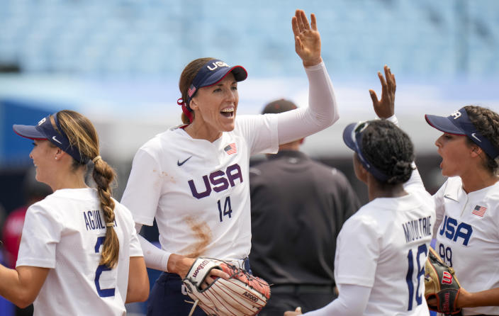 United States' Monica Abbott celebrates with teammates during the softball game between the United States and Canada at the 2020 Summer Olympics, Thursday, July 22, 2021, in Fukushima , Japan. (AP Photo/Jae C. Hong)
