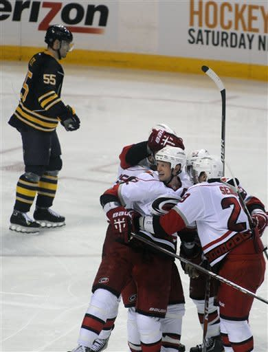 Buffalo Sabres' Jochen Hecht (55) reacts as the Carolina Hurricanes celebrate a goal by Alexander Semin during the third period of an NHL hockey game in Buffalo, N.Y., Friday, Jan. 25, 2013. Carolina won 3-1. (AP Photo/Gary Wiepert)