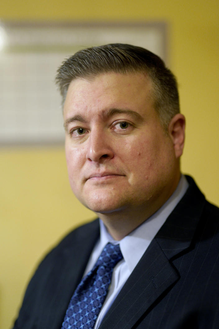 """Tom Freeman, a moderate Republican and attorney in Lincoln, Neb., poses Friday, Oct. 26, 2018, for a photo in Omaha, Neb. As authorities intercepted bombs addressed to Trump's critics, political scientists and ordinary Americans wondered if this latest violence might be the moment that the country would collectively consider how poisonous its political culture had become, and decide to turn the other way. Freeman said, """"It's just kind of round and round we go, and the sides just get more and more extreme, and you don't have that rational leader in the crowd saying, 'Hey; let's dial it back.' The sad thing is, if you did have that person, I don't know that anyone would listen to them."""" (AP Photo/Nati Harnik)"""