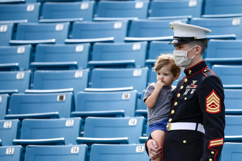 JACKSONVILLE, FLORIDA - NOVEMBER 08: General view of a US Marine looking on while holding a child prior to the game between the Jacksonville Jaguars and the Houston Texans at TIAA Bank Field on November 08, 2020 in Jacksonville, Florida. (Photo by Douglas P. DeFelice/Getty Images)