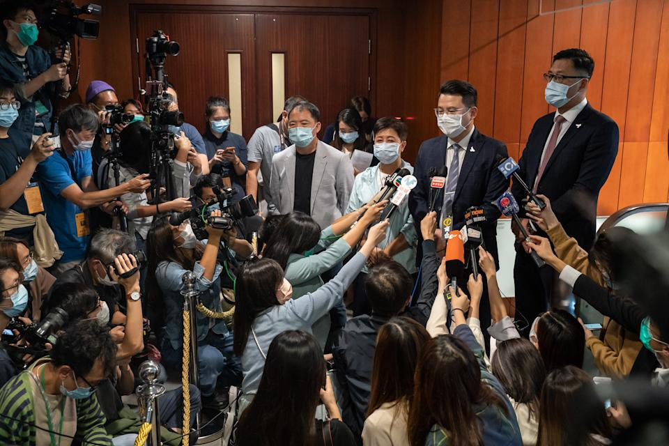 HONG KONG, CHINA - NOVEMBER 12: Pro-democracy lawmakers Helena Wong, Wu Chi-wai, Andrew Wan Siu-kin and Lam Cheuk-ting speaks to members of media after tendering their letters of resignation at the Legislative Council on November 12, 2020 in Hong Kong, China. Hong Kong's government removed four pro-democracy lawmakers from the city's legislative council after China passed a ruling that allowed for the disqualification of lawmakers deemed to be unpatriotic, a move that could result in a mass resignation by the pro-democracy camp. (Photo by Anthony Kwan/Getty Images)