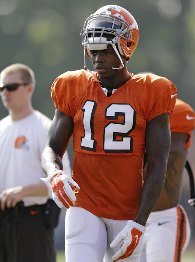 Cleveland Browns wide receiver Josh Gordon takes a break during practice at the NFL football team's training camp Monday, Aug. 4, 2014, in Berea, Ohio. Gordon returned to practice while his appeal hearing with the NFL enters a second day in New York. Gordon missed two days of practice last week and Saturday's scrimmage in Akron. Gordon and his legal team met with an arbitrator for nearly 10 hours on Friday as he fights a potential one-year suspension for violating the league's substance abuse policy.(AP Photo/Tony Dejak)