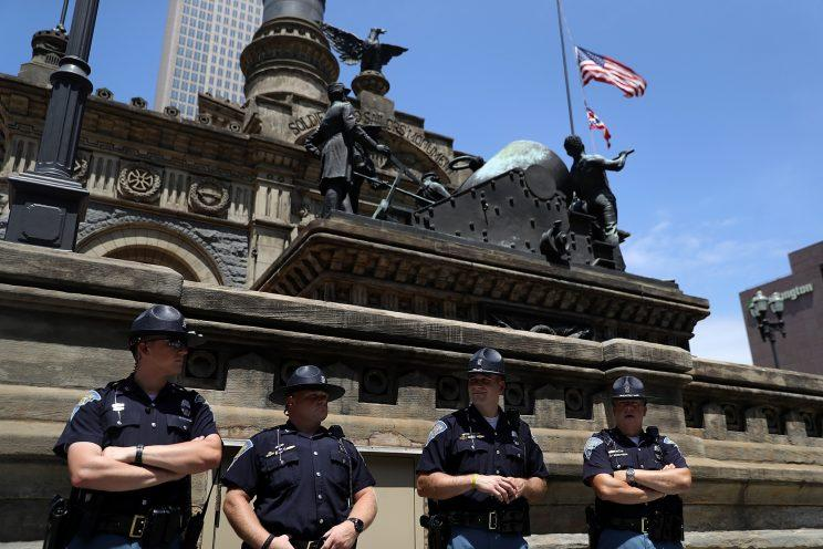 Indiana State Police officers stand guard in Cleveland Public Square near the site of the Republican National Convention on July 18, 2016 in Cleveland, Ohio.