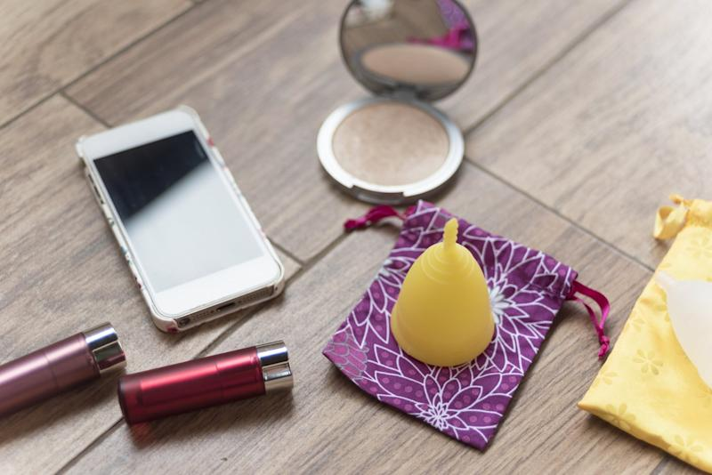 Menstrual cup, mobile and some beauty stuff, everything what a modern girl or woman needs for her period.