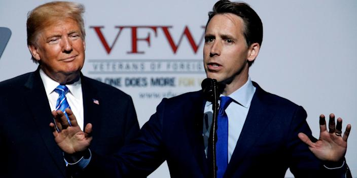 Missouri Attorney General and Republican US Senate candidate Josh Hawley talks while President Donald Trump listens during an appearance at the Veterans of Foreign Wars national convention, July 24, 2018, in Kansas City, Missouri.