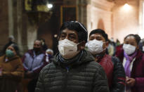 Catholic faithful wearing masks to curb the spread of the new coronavirus attend a Mass at the San Francisco Basilica in La Paz Bolivia, Sunday, Sept. 27, 2020. Churches have reopened for Mass after being closed for months because of the pandemic lockdown. (AP Photo/Juan Karita)