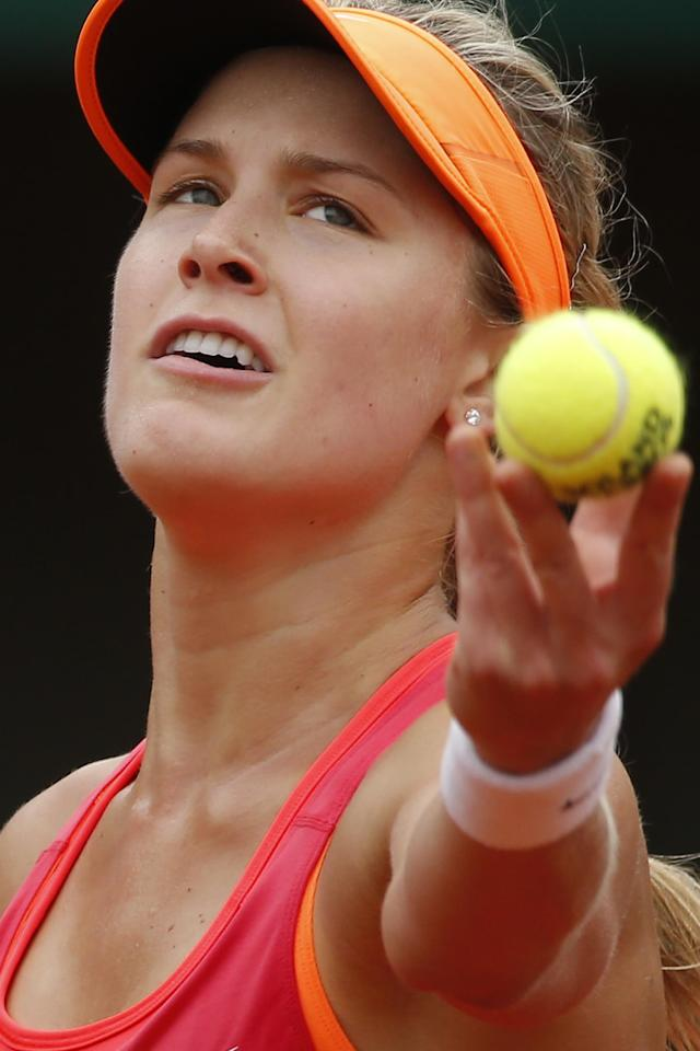 Canada's Eugenie Bouchard serves the ball during the fourth round match of the French Open tennis tournament against Germany's Angelique Kerber at the Roland Garros stadium, in Paris, France, Sunday, June 1, 2014. (AP Photo/Michel Euler)