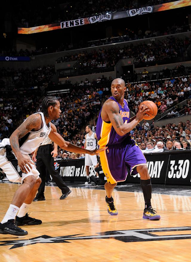 Kobe Bryant #24 of the Los Angeles Lakers drives against Kawhi Leonard #2 of the San Antonio Spurs on April 20, 2012 at the AT&T Center in San Antonio, Texas. (D. Clarke Evans/NBAE via Getty Images)