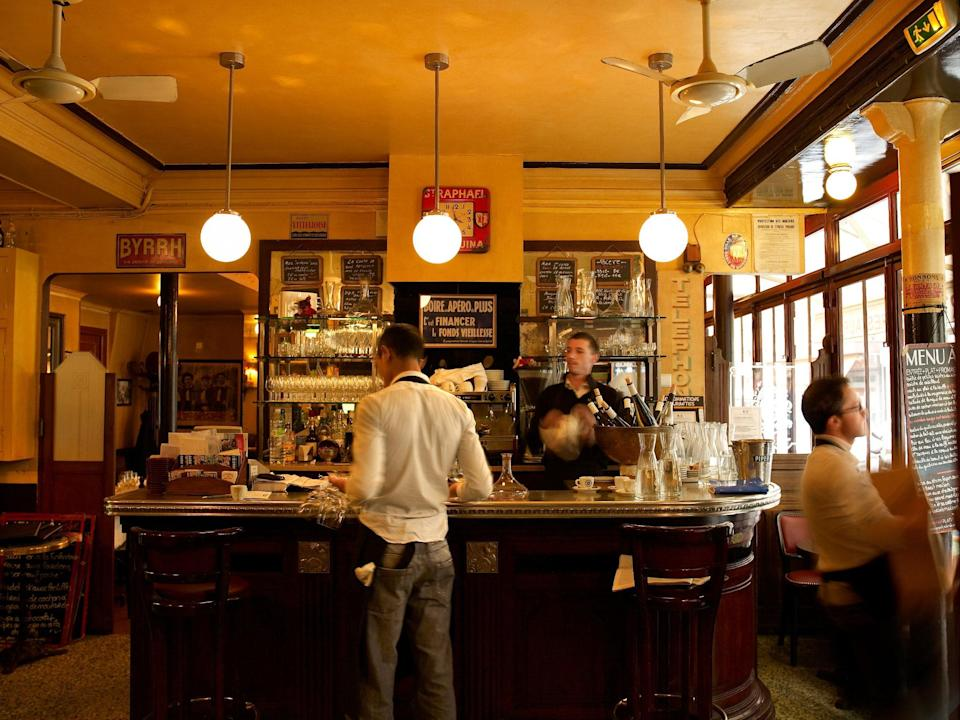 """<p><strong>Tell us about your first impressions when you arrived.</strong><br> Despite its rough-around-the-edges, old-school decor (spotty mirrors, chalkboard menu, mosaic tiles, white aproned waiters, etc.) this bistro actually opened in more modern times—specifically, at the turn of the 21st century. You'll be greeted almost immediately with a """"bonjour"""" after which they'll either check their giant reservation book for your name before guiding you to your seat through one of three rooms or apologize for not having an available table. (You might get lucky, though; it's worth dropping in if you didn't plan ahead. At the very least, there's small plates and superb wine from La Cave Paul Bert down the street from the same owners.)</p> <p><strong>What was the crowd like?</strong><br> While they do serve a fair share of locals, the place is mostly filled with international tourists speaking English while getting their steak frites fix. Because it's well-lit and boisterous, you'll also see a lot of families or larger groups as opposed to romantic dinner dates. It's a mix of foreigners just looking to check-off sole meunière from their must-eat list, but also foodies who appreciate such classics being approached with precision in addition to serving other traditional, yet seasonal dishes.</p> <p><strong>What should we be drinking?</strong><br> Definitely more of a wine-with-dinner bistro as opposed to cocktails. Serious wine aficionados (and anyone waiting for a table) could hop down the block to Le Cave Paul Bert where they offer an ever-changing selection of wines.</p> <p><strong>Main event: the food. Give us the lowdown—especially what not to miss.</strong><br> There's no escaping a food coma following a meal here. This is a gut-busting traditional French meal at its finest—from the seasonal plump white asparagus and the Côte de Boeuf for two (served medium-rare only with the most perfect French fries) to their signature praline-buttercream-filled Paris-Brest pastry or"""