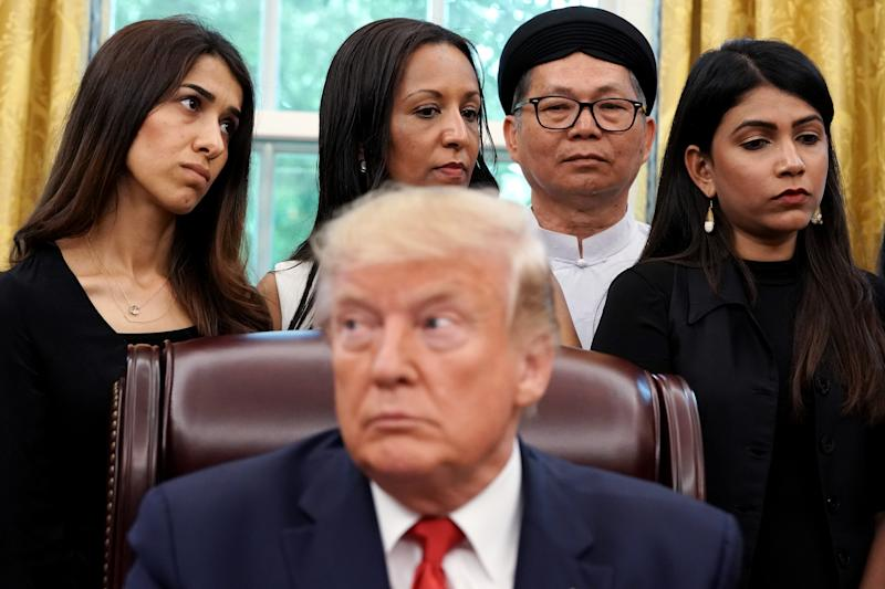 WASHINGTON, DC - JULY 17: U.S. President Donald Trump hosts survivors of religious persecution from 17 countries around the world, including Iraqi Yazidi human rights activist and Nobel Peace Prize winner Nadia Murad (L), in the Oval Office at the White House July 17, 2019 in Washington, DC. The survivors are in Washington to attend a State Department conference on religious freedom. (Photo by Chip Somodevilla/Getty Images)