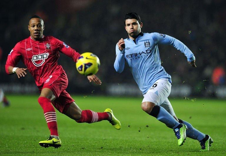 Manchester City striker Sergio Aguero (R) competes with Southampton defender Nathaniel Clyne, on February 9, 2013