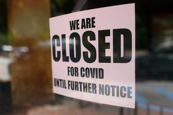 A closed sign in the window of a store in Athens, Ga., on May 1, 2020.