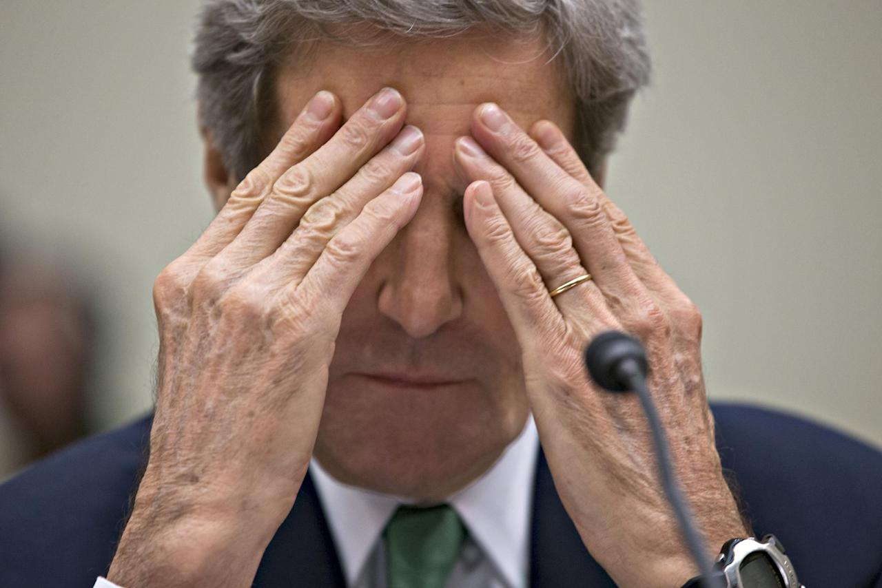 Secretary of State John Kerry rubs his eyes while testifying on Capitol Hill in Washington, Tuesday, Dec. 10, 2013, before the House Foreign Affairs Committee in the hope of persuading Congress to not forge any new economic sanctions on Iran that could break the recent historic agreement that would end Iran's progress toward weapons-grade uranium. The deal struck in Geneva prohibits the Obama administration from introducing new sanctions for six months. Iran's foreign minister has said any new package of commercial restrictions would break the agreement. (AP Photo/J. Scott Applewhite)