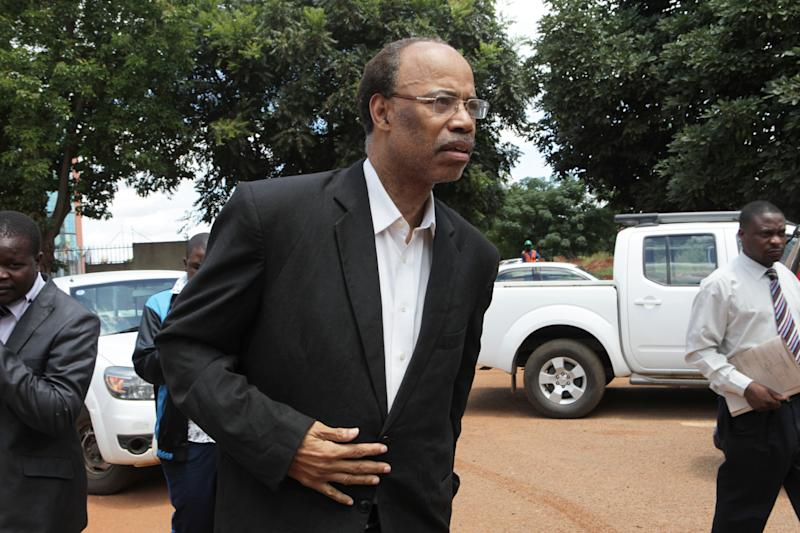 Former U S Congressman, Mel Reynolds, arrives to appear at the magistrates courts in Harare, Wednesday, Feb. 19, 2014. Reynolds was arrested in Zimbabwe for allegedly possessing pornographic material and violating immigration laws. (AP Photo/Tsvangirayi Mukwazhi)