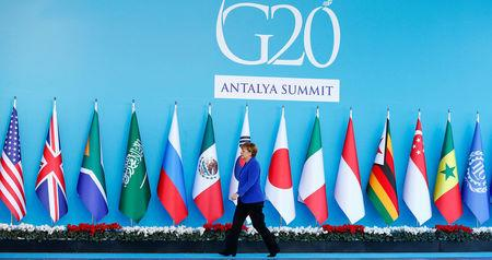 FILE PHOTO: German Chancellor Merkel arrives for welcoming ceremony during G20 summit in Antalya