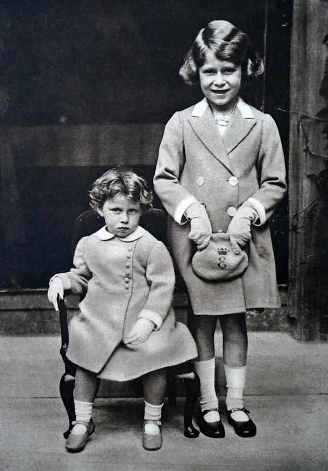 <p>It's unclear when this photo was taken, but we see an older Princess Elizabeth posing next to her younger sister, Princess Margaret. </p>