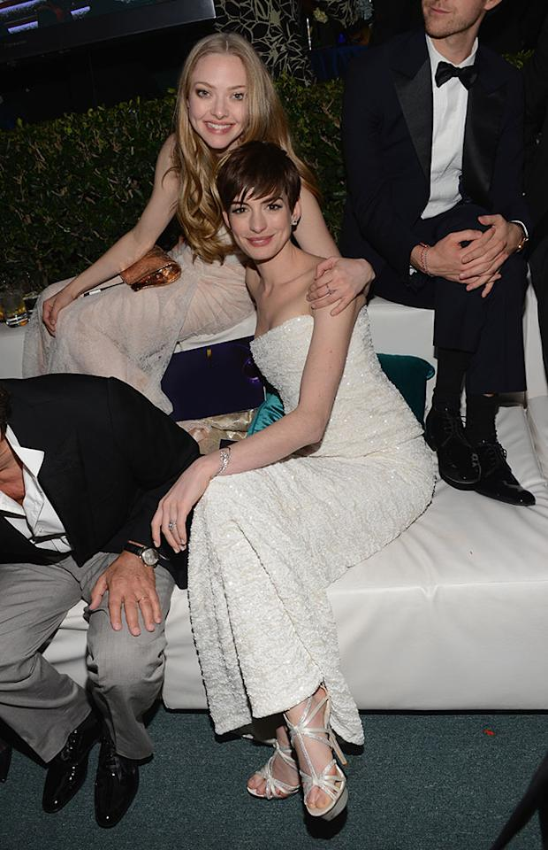 Amanda Seyfried and Anne Hathaway attend the NBCUniversal Golden Globes viewing and after party held at The Beverly Hilton Hotel on January 13, 2013 in Beverly Hills, California.
