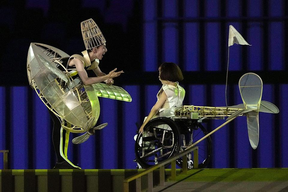 <p>In a message about pushing past challenges, a young Japanese girl played a one-winged plane in an opening ceremony skit.</p>