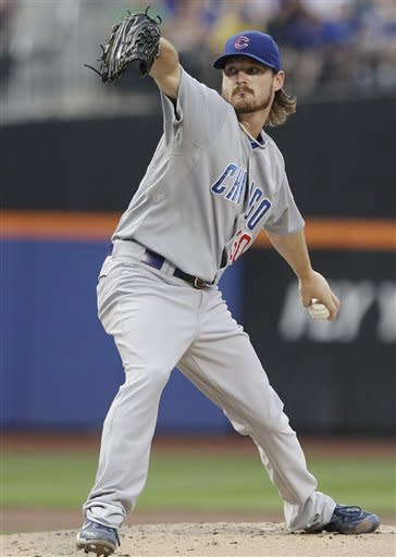 Chicago Cubs' Travis Wood pitches during the first inning of a baseball game against the New York Mets on Friday, July 6, 2012, in New York. (AP Photo/Frank Franklin II)