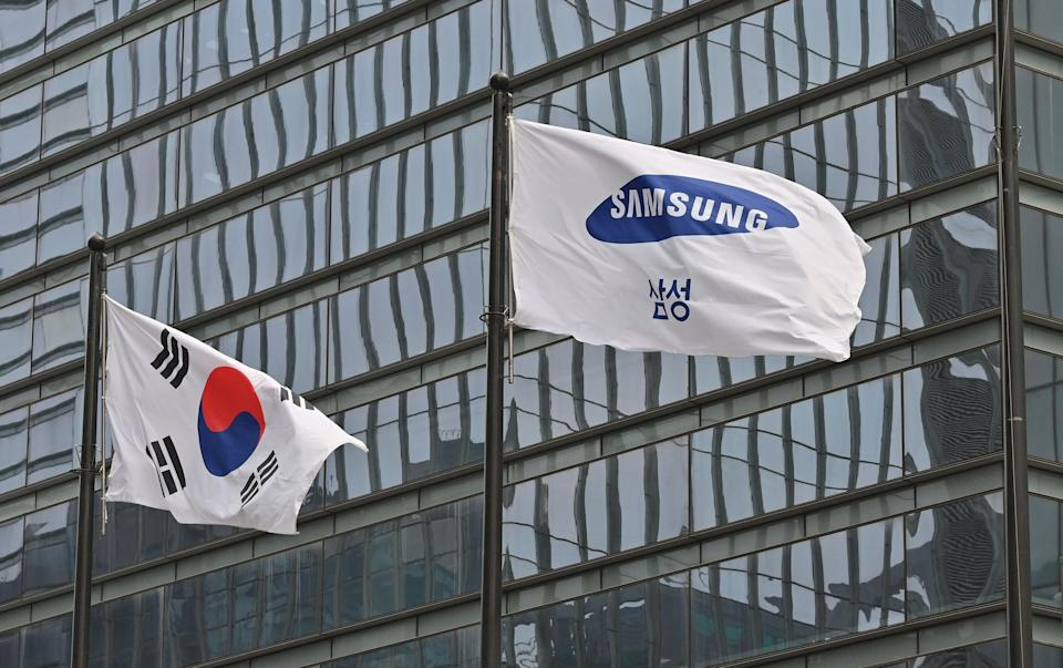 <p>File image: A Samsung flag and South Korean national flag flutter at the company's Seocho building in Seoul</p> (Getty Images)