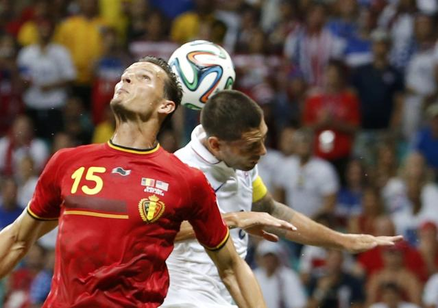 Clint Dempsey of the U.S. jumps for the ball with Belgium's Daniel Van Buyten during their 2014 World Cup round of 16 game at the Fonte Nova arena in Salvador July 1, 2014. REUTERS/Sergio Moraes (BRAZIL - Tags: SOCCER SPORT WORLD CUP)