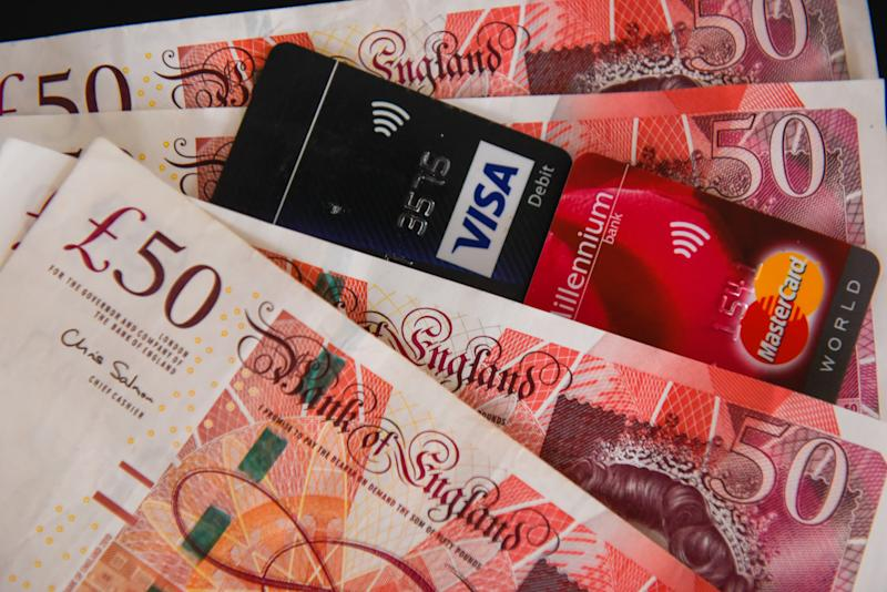 Fifty pounds bank notes and a visa and mastercard atm cards