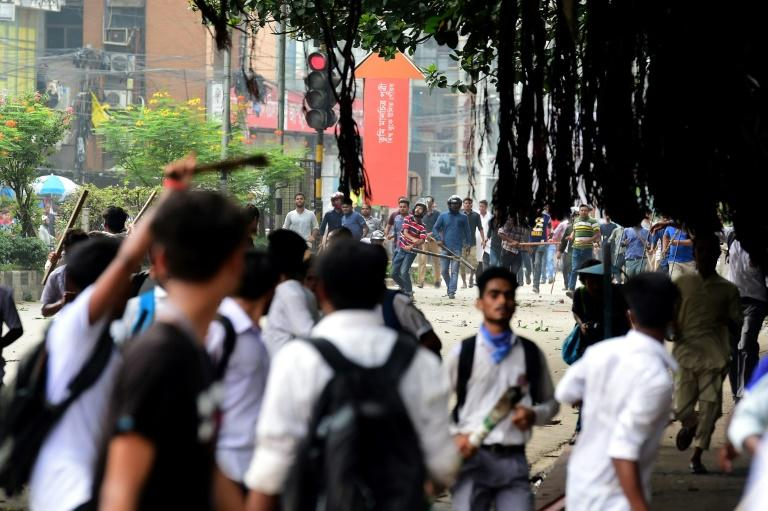 Students could be seen clashing with unidentified men who wielded clubs and stones