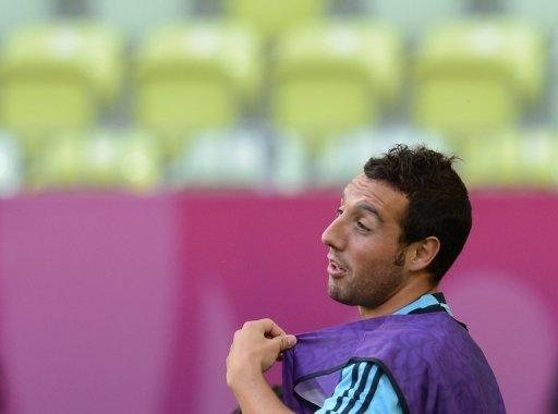 Arsenal manager Arsene Wenger denied he was close to signing Spain's Santi Cazorla, pictured in June 2012, as the English football giants kicked off an Asian tour Tuesday with a narrow 2-1 victory over hosts Malaysia