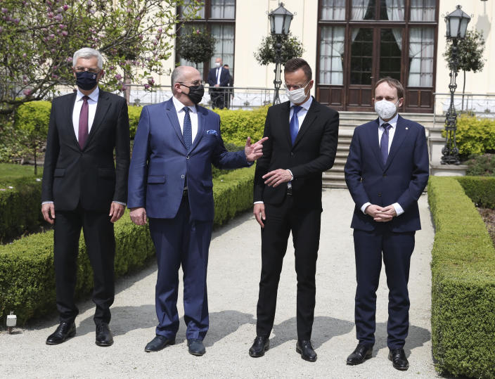 Slovak Foreign Minister Ivan Korcok, left, Polish Foreign Minister Zbigniew Rau, Hungarian Foreign Minister Peter Szijjarto and Czech Republic Foreign Minister Tomas Petricek, right, after meeting the foreign ministers of the Visegrad Group ,V4, in Lodz, Poland, Friday, May 14, 2021. (AP Photo/Czarek Sokolowski)