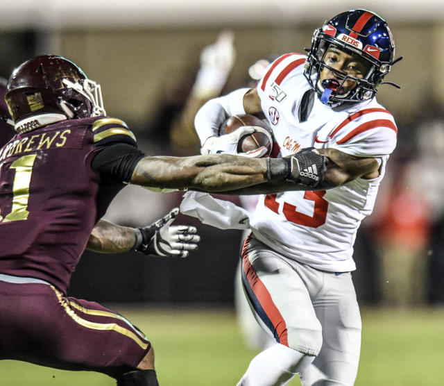 Mississippi wide receiver Braylon Sanders (13) is grabbed by Mississippi State safety Jaquarius Landrews (11) during an NCAA college football game in Starkville, Miss., Thursday, Nov. 28, 2019. (Bruce Newman/The Oxford Eagle via AP)