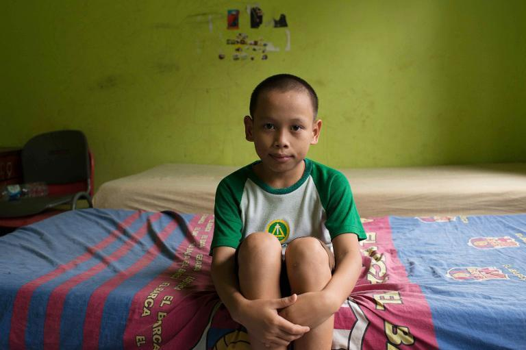 This picture taken on October 31, 2013, shows an Indonesian young boy called Fazri, attending Italian violinist Sara Michieletto's class at a shelter for less fortunate children in Bekasi in the outskirt city of Jakarta