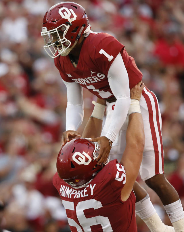Oklahoma quarterback Kyler Murray (1) celebrates with teammate Creed Humphrey (56) after a touchdown against Army in the first half of an NCAA college football game in Norman, Okla., Saturday, Sept. 22, 2018. (AP Photo/Sue Ogrocki)