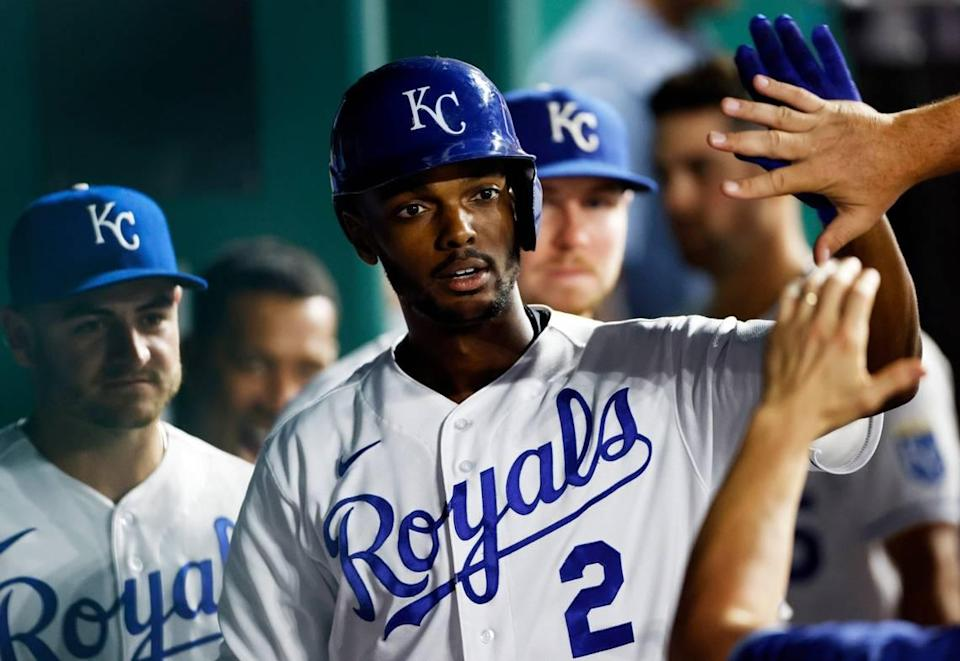 Kansas City Royals outfielder Michael A. Taylor is congratulated in the dugout after hitting a home run during the fifth inning against the Seattle Mariners at Kauffman Stadium in Kansas City, Mo., Saturday, Sept. 18, 2021.