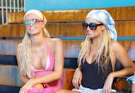 <p>Their swimsuits wouldn't be complete without silk headscarves.</p>
