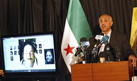 Abdeltawwab Shahrour, head of the forensic medicine committee in Aleppo, speaks during a news conference in Istanbul September 10, 2013. REUTERS/Murad Sezer