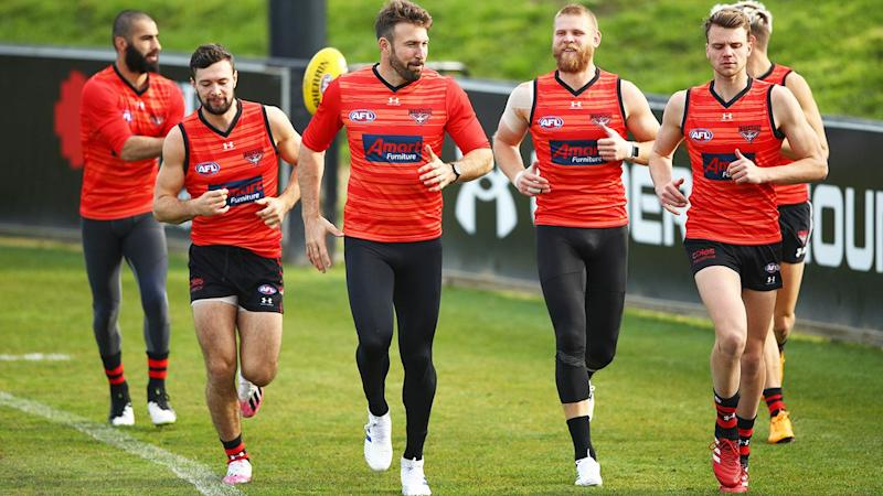 Conor McKenna (second from left) with teammates at Essendon training.