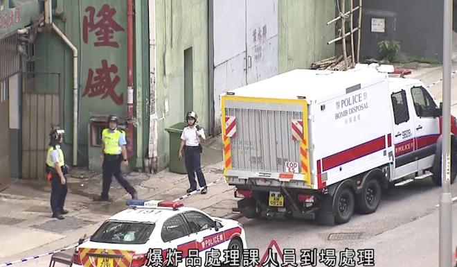 Police have arrested three men after finding explosives during a raid on an industrial block in Tsuen Wan Photo: TVB News