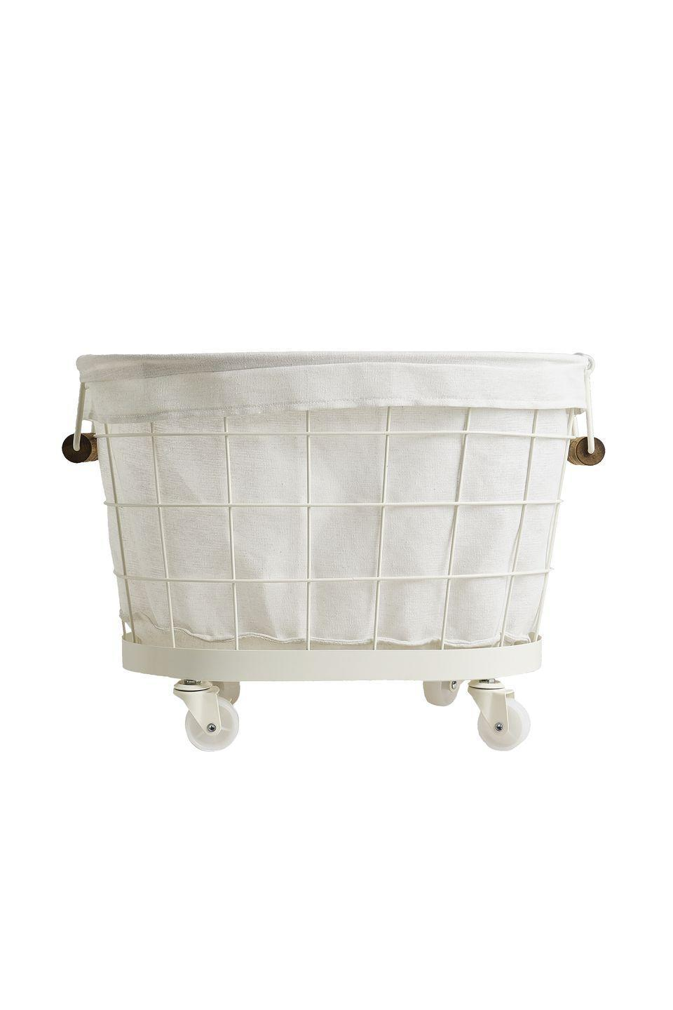 """<p>The perfect size for a load of laundry, this handy basket can be easily wheeled from your washing machine to the drying line. Plus, in a winningly neutral mix of white lacquered metal and linen-coloured waterproof fabric, it will suit any interior. £69.99, <a href=""""https://www.zarahome.com/gb/lacquered-metal-basket-with-wheels-l49275049"""" rel=""""nofollow noopener"""" target=""""_blank"""" data-ylk=""""slk:zarahome.com"""" class=""""link rapid-noclick-resp"""">zarahome.com</a></p>"""